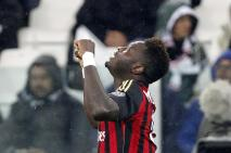 AC Milan's Muntari celebrates after scoring against Juventus during their Italian Serie A match in Turin